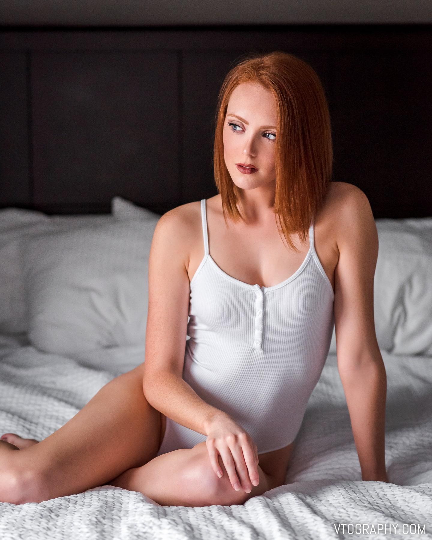 Red haired model Ashley in white bodysuit